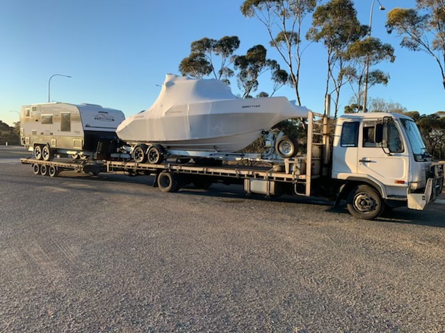Whittley 2600 and a Montanna Caravan being Transported to Perth Western Australia